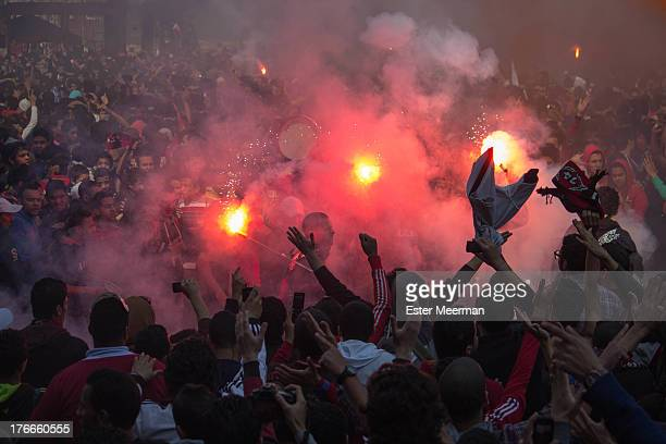 Members of the football club Al Ahly, also known as the Ultras, celebrate the second verdict in the case of the Port Said massacre at the Al Ahly...