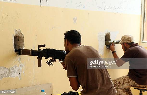 TOPSHOT Members of the forces loyal to Libya's UNbacked Government of National Accord guard a lookout point in the coastal city of Sirte east of the...