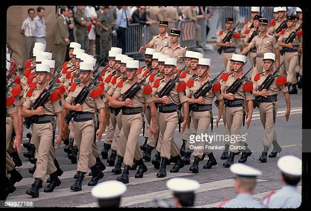 Members of the Foreign Legion march in uniform down the ChampsElysees for the French bicentennial They carry machine guns and walk in a Defile...