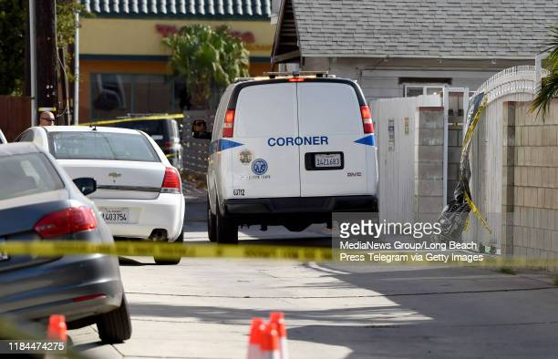 Members of the forensics team gather evidence at the scene of a shooting that killed 3 and wounded 9 Tuesday night in the 2700 block of 7th Street...