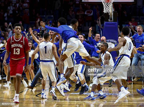 Members of the Fort Wayne Mastodons celebrate after upsetting the Indiana Hoosiers 7168 in overtime at Memorial Coliseum on November 22 2016 in Fort...