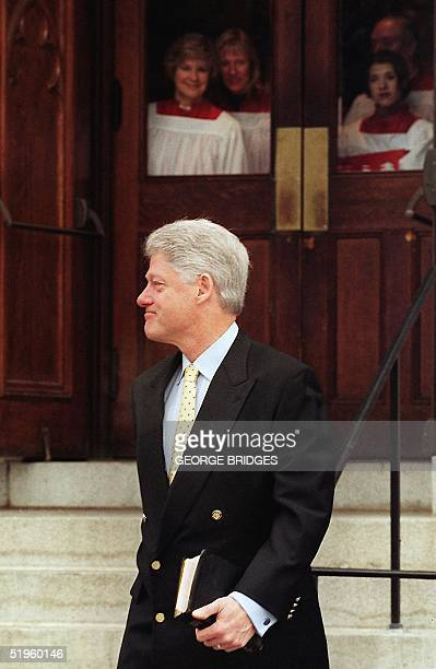 Members of the Foundry United Methodist Church choir watch as US President Bill Clinton departs following Sunday services 23 January 2000 in...