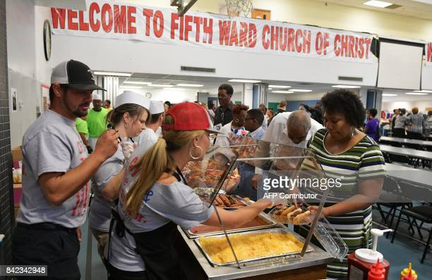 Members of the Franklin Church of Christ from Franklin Texas dish out lunch to the congregation of the Fifth Ward Church of Christ in Houston on...