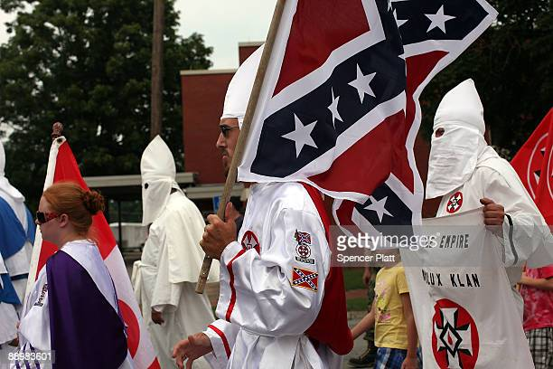 Members of the Fraternal White Knights of the Ku Klux Klan participate in the 11th Annual Nathan Bedford Forrest Birthday march July 11 2009 in...