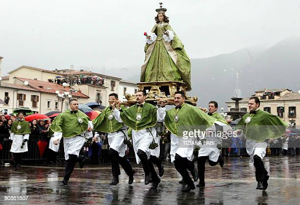 Members of the fraternity of St Mary of Loreto carry the statue of the Virgin Mary during an Easter procession through the streets of Sulmona in...