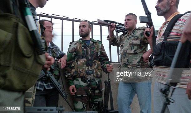 Members of the Free Syrian Army are pictured in the village of Azzara on the outskirts of flashpoint city of Homs on June 28 2012 The Syrian army...