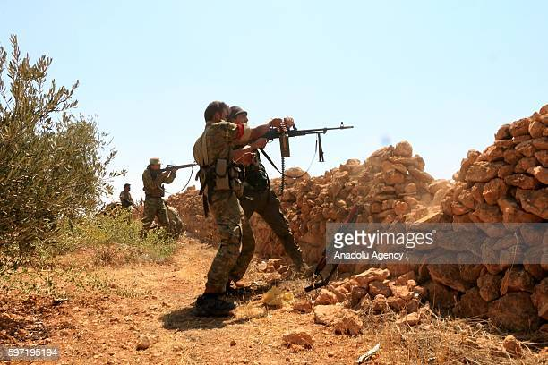 Members of the Free Syrian Army make preparations to attack PYD/PKK terrorists around Bir Al Kusa village after taking control of the village from...