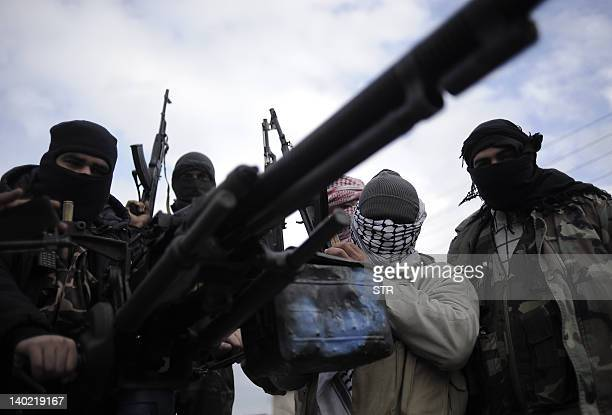 Members of the Free Syrian Army patrol an area in Qusayr 15 kms from Homs on January 24 2012 The United Nations said that well over 7500 people have...