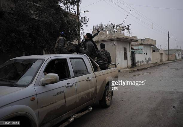 Members of the Free Syrian Army patrol an area in Qusayr 15 kms from Homs on January 25 2012 The United Nations said that well over 7500 people have...