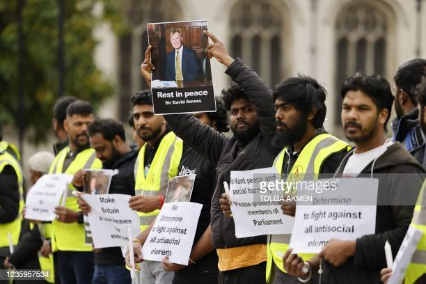 Members of the Freedom Hunters For Tamils rights activist organisation hold up photographs and placards in honour of killed British lawmaker David...