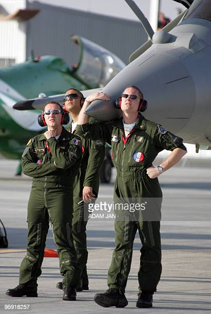 Members of the French Air Force team watch the sky during an air show at teh Sakhir Airbase in Manama on January 21 2010 The threeday Bahrain...
