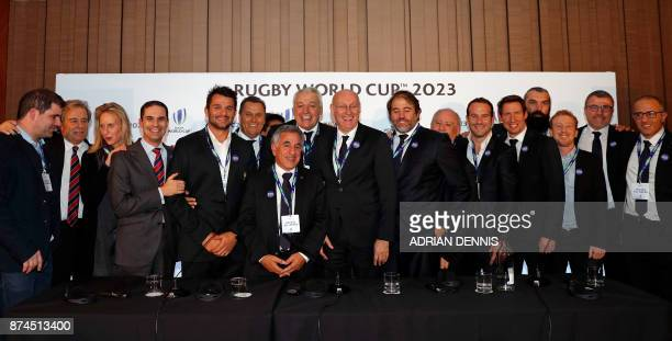 Members of the French bid including President of the French bid Claude Atcher and French rugby President Bernard Laporte pose after France was named...