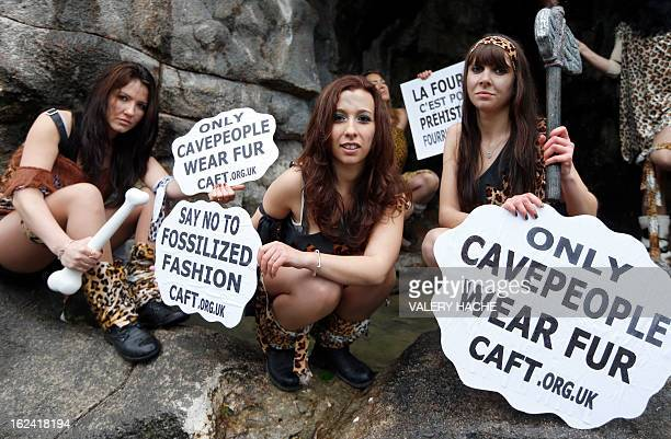 Members of the French branch of the international antifur group CAFT dressed as cavemen demonstrate against the production and use of animal fur on...