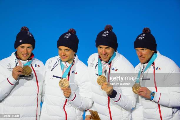 Members of the French bronze medallist team Jean Marc Gaillard Maurice Manificat Clement Parisse and Adrien Backscheider celebrate during the medal...