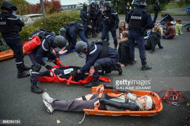 Members of the French Departmental Service of Fire and Rescue take care of the victims during an exercise simulating a terrorist attack inside the...