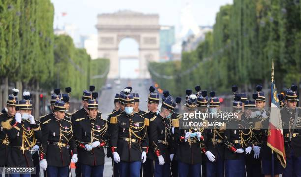 TOPSHOT Members of the French Genrdarmerie Nationale wearing protective facemasks arrive prior to the annual Bastille Day military ceremony on the...