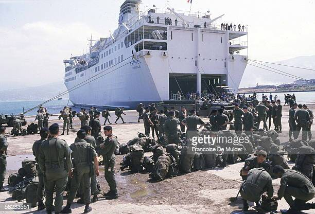 Members of the French Marine contingent of the Multinational Force get their bags and equipment ready to load onto the ferry Esterel as they prepare...