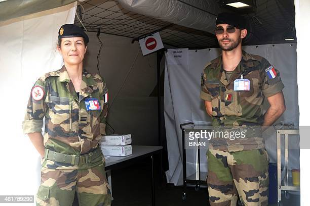 Members of the French military stand outside a tent at a medical center erected at Conakry's International airport on January 19 2015 as the country...