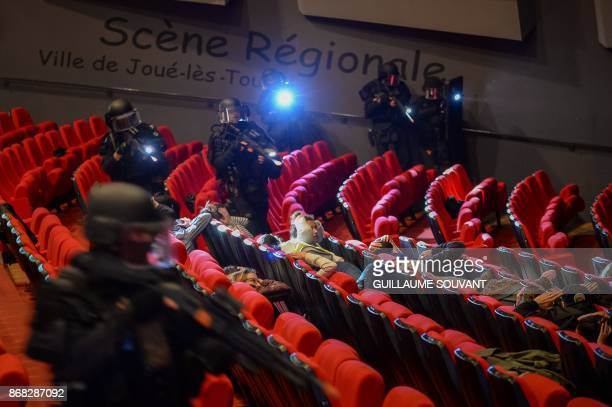 Members of the French National Gendarmerie Intervention Group the elite tactical unit of the Gendarmerie enter in the theatre to evacuate the...