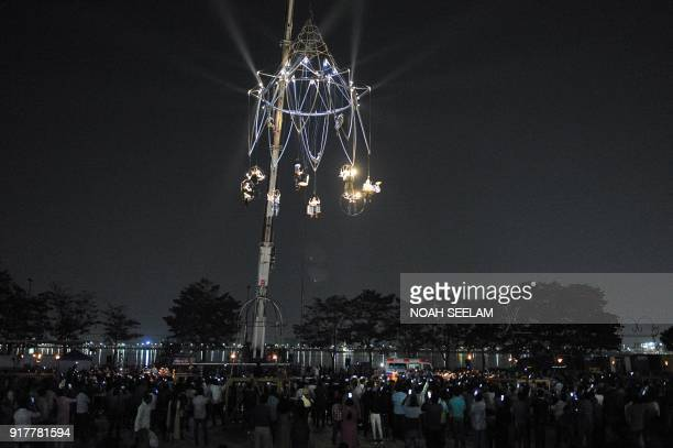 Members of the French performance company 'Transe Express' take part in the 'Enchanted Chandelier' aerial show in Hyderabad on February 13 as a part...