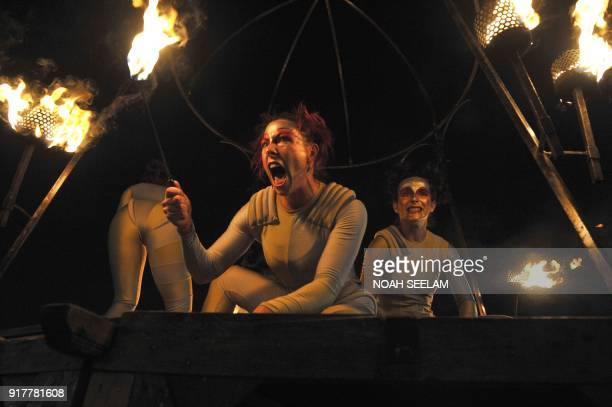 Members of the French performance company 'Transe Express' take part in the 'Enchanted Chandelier' show in Hyderabad on February 13 as a part of...