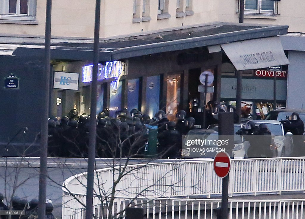 Members of the French police special forces launch the assault at the Hyper Cacher Kosher grocery store in Porte de Vincennes, eastern Paris, where at least two people were shot dead on January 9, 2015 during a hostage-taking drama at a Jewish supermarket in eastern Paris, and five people were being held, official sources told AFP. Several hostages were freed after French commandos stormed a Jewish supermarket in eastern Paris where an assailant was holed up on January 9. After several explosions, police stormed the shop in Portes de Vincennes and everal hostages exited the store shortly afterwards and were taken to safety.