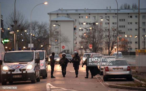 Members of the French police special forces RAID take part in an operation on December 13 2018 in Strasbourg as part of the hunt for the gunman who...
