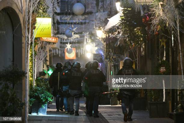 Members of the French police unit BRI conduct searches in the rue des orfevres on December 12 2018 for the gunman who opened fire near a Christmas...