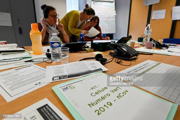 Members of the French Regional Health Agency answer the phone of a tollfree number for people with concerns over the COVID19 outbreak caused by the...