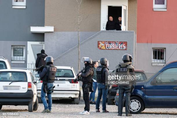 Members of the French Research and Intervention Brigade secures the area during a search operation at the Ozanam housing estate in Carcassonne...