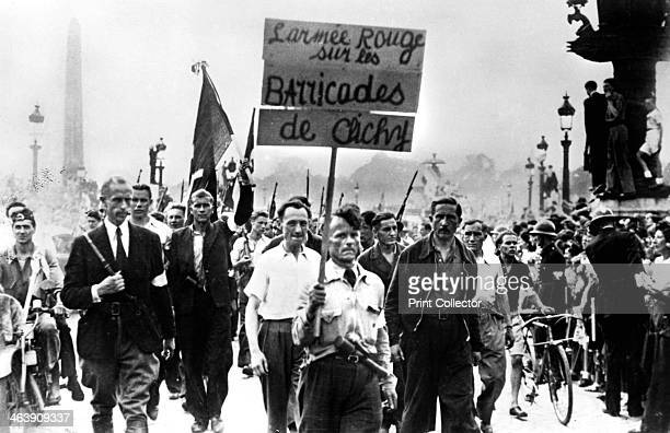 Members of the French Resistance marching through the Place de la Concorde, liberation of Paris, August 1944. The placard reads: The Red Army on the...