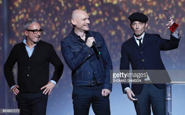 Members of the French rock band Louise Attack violinist Arnaud Samuel singer and guitarist Gaetan Roussel and bassist Robin Feix celebrate after...