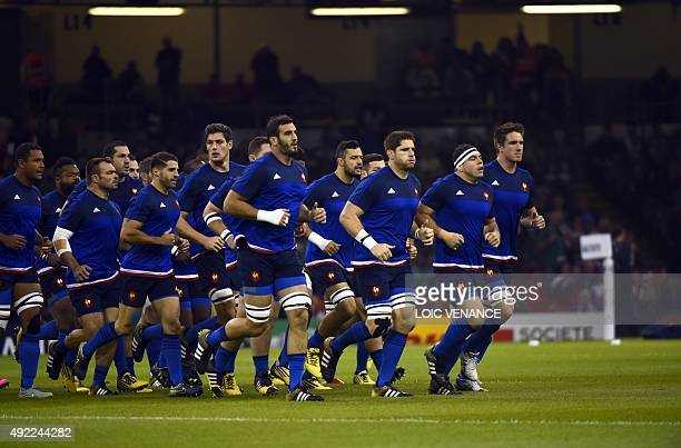 Members of the French rugby squad warm up ahead of a Pool D match of the 2015 Rugby World Cup between France and Ireland at the Millennium Stadium in...