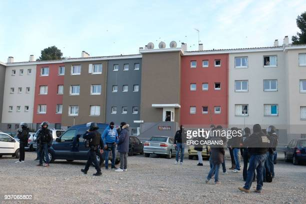 Members of the French security forces secure the area during a search operation at the Ozanam housing estate in Carcassonne southwestern France on...