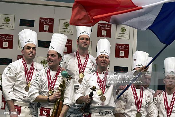 Marc Riviere Etienne LeroyJeanThomas Schneider and Bastien Girard celebrate as they receive their trophy after winning the final of the World Cup of...