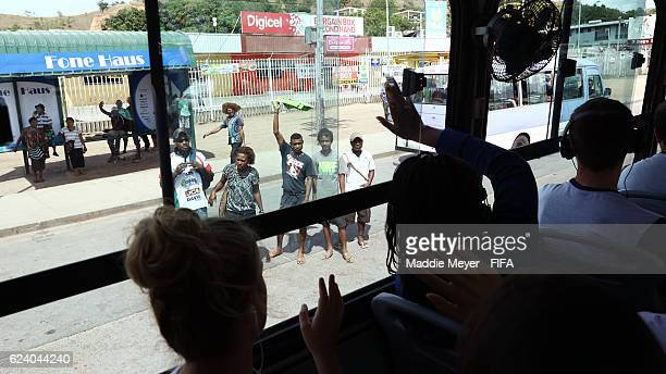Members of the French team wave to people on the street on the way to Port Moresby Nature Park on November 18 2016 in Port Moresby Papua New Guinea