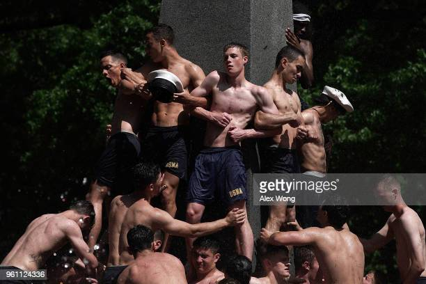 Members of the freshman class participate in the annual Herndon Monument Climb May 21 2018 at the US Naval Academy in Annapolis Maryland The first...