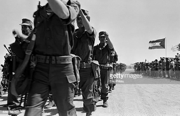 Members of the Front Polisario march in a military parade The acronym stands for por la liberacion de Saguiat el Hamra y Rio de Oro