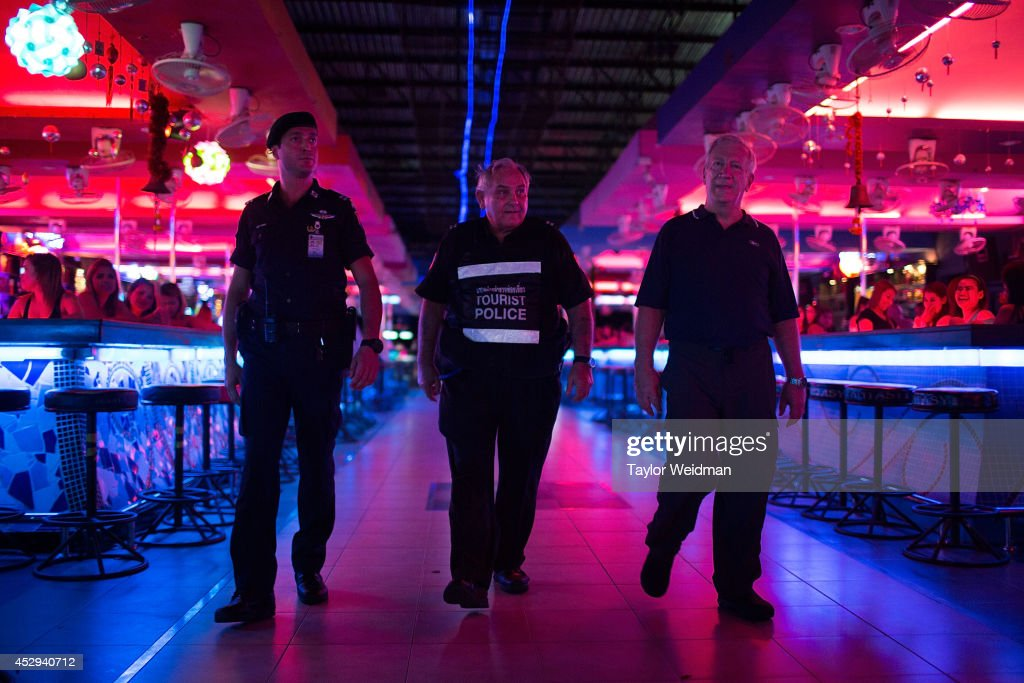 Members of the FTPA patrol a bar area near Pattaya's Walking Street on July 31, 2014 in Pattaya, Thailand. Since 2002, members of the Foreign Tourist Police Assistants (FTPA) of Pattaya have been assisting local police on Walking Street, Pattaya's main nightlife area. Members of the FTPA carry handcuffs, batons, and pepper spray, and are charged primarily with assisting foreign visitors and the Thai police, as well as breaking up fights and catching thieves.