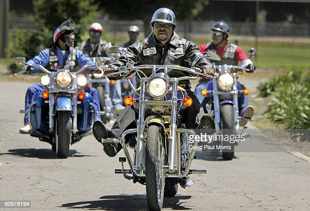 Members of the Fugitives Motorcycle Club ride into the Juneteenth Black Independence Day celebrations at Nichol Park on June 19 2004 in Richmond...