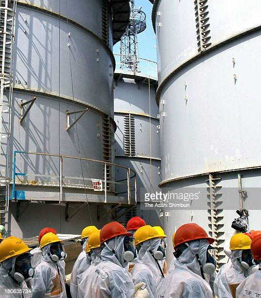 Members of the Fukushima Prefecture panel inspect Tokyo Electric Power Co Fukushima Daiichi Nuclear Power Plant on September 13 2013 in Okuma Japan...