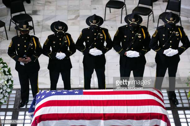 Members of the Fulton County Sheriff's Office Honor Guard stand at attention in front of former US Rep. John Lewis as he lies in state at the Georgia...