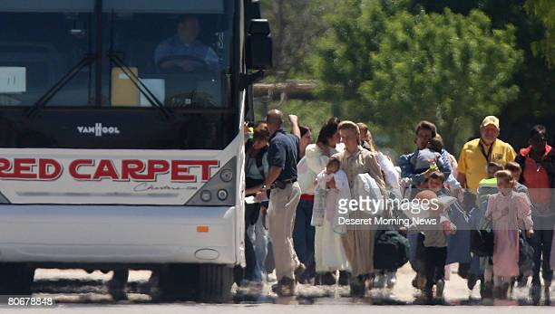 Members of the Fundamentalist Church of Jesus Christ of Latter Day Saints are loaded onto charter buses outside Fort Concho before being transported...