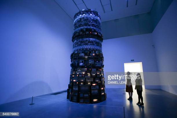 Members of the gallery pose for a picture in front of an installation by Brazilian artist Cildo Meireles named Babel 2001 at the Tate Modern gallery...