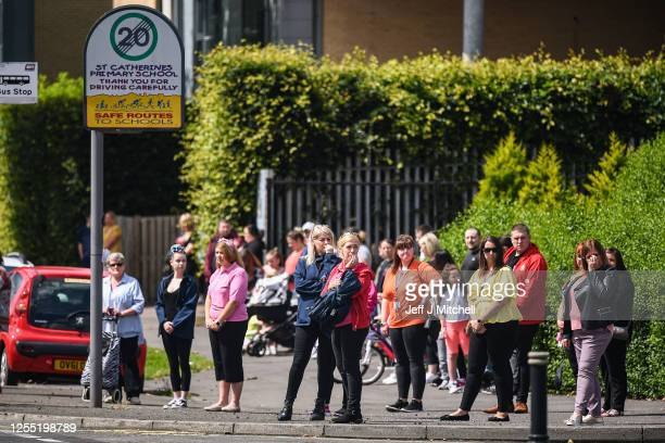 Members of the Gallowhill community watch as the the funeral cortege for Fiona Gibson Alexander James Gibson eight and fiveyearold Philip Gibson...