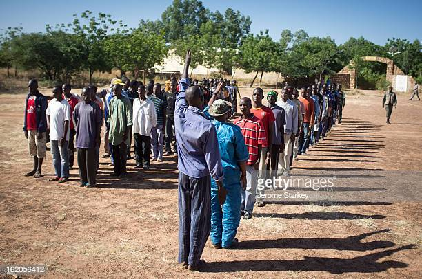 CONTENT] Members of the Ganda Izo militia at a makeshift military base south a few kilometres south of Mopti just within government territory in...