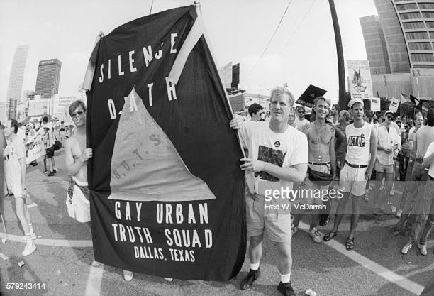 Members of the Gay Urban Truth Squad with a 'Silence Equals Death' banner demonstrate outside the Omni Hotel during the Democratic National...