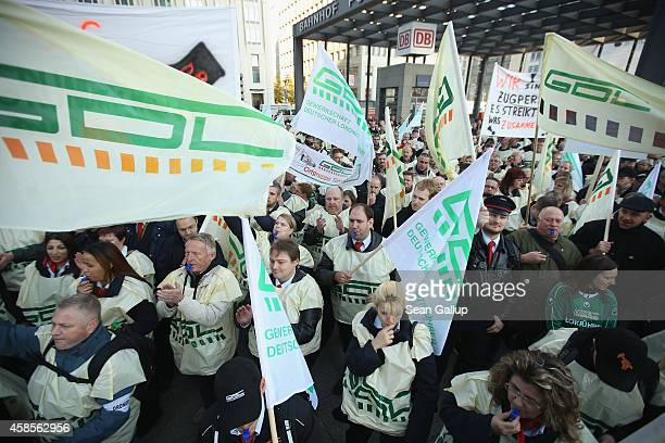 Members of the GDL train drivers labor union protest on Potsdamer Platz outside the corporate headquarters of German state rail carrier Deutsche Bahn...