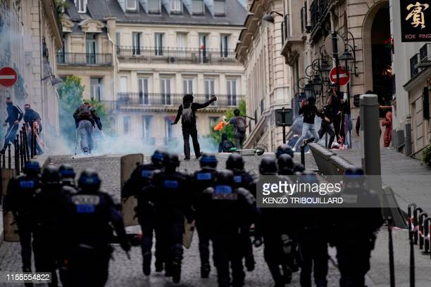 TOPSHOT Members of the Gendarmerie charge as protestors linked to the Yellow Vests movement take part in a demonstration on the side of the annual...