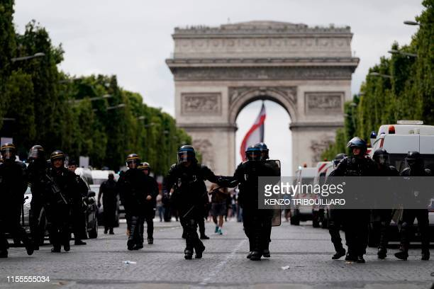 Members of the Gendarmerie stand in front of the Arc de Triomphe as protestors linked to the Yellow Vests movement take part in a demonstration on...